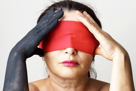 Tied mouth and blindfold eyes.Censored and freedom of speech photo