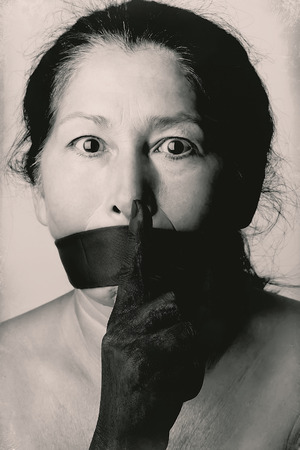 speechless: Tied mouth and blindfold eyes.Censored and freedom of speech