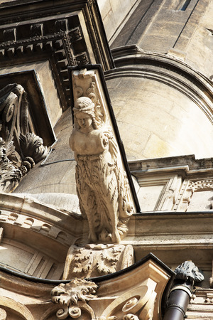 grotesque: Stone grotesque female-gargulya in a cathedral Stock Photo