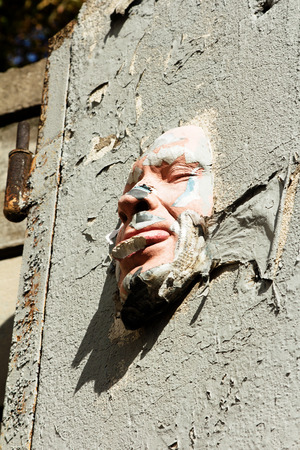 Paris, France september 25, 2014: Face mask at a wall. street art from Gregos who creates replicas of his face. Stock Photo