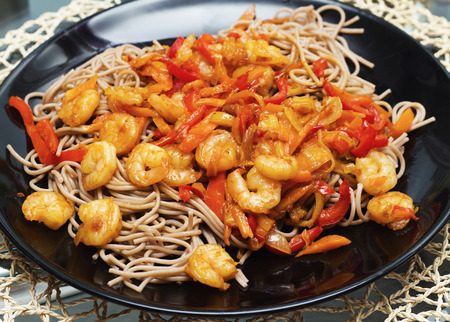 Pasta spaghetti with shrimps and vegetables photo