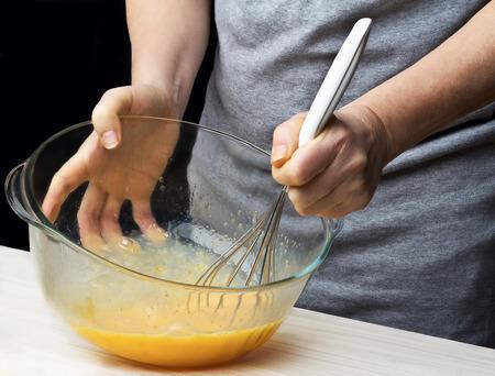 black hand: Making sponge cake. Series. Stock Photo