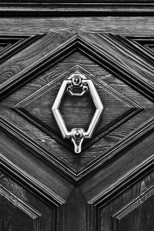 Old wooden door with metal knocker photo