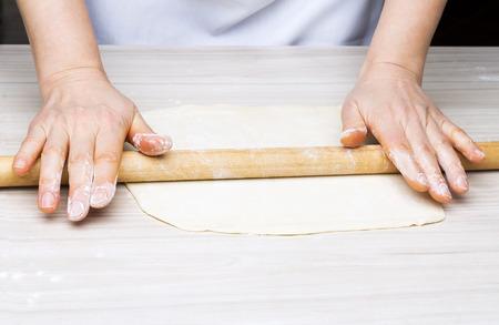 Woman39s hands knead dough. photo
