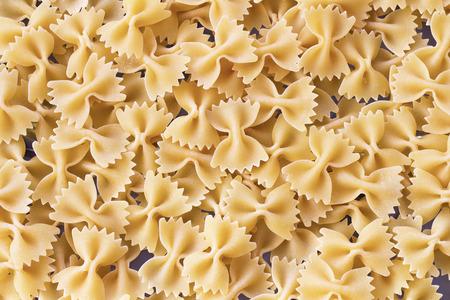 pastas: Pasta italiana textura de fondo de alimentos crudos. Foto de archivo