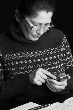 woman searching: Woman searching for information in a smart-phone