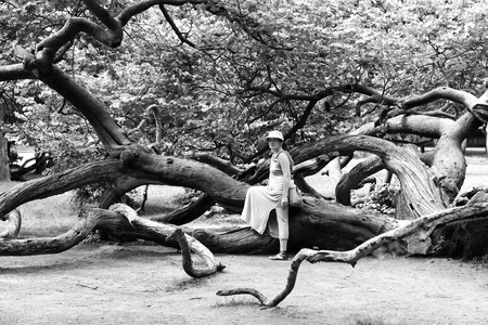 mature woman near a tree in the park.
