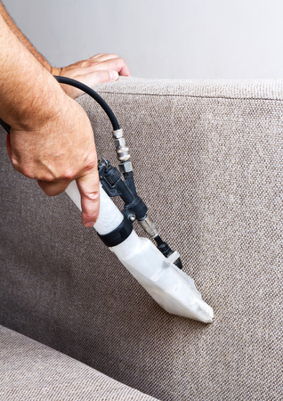 cleaning background: Professional cleaning of the upholstery on a sofa