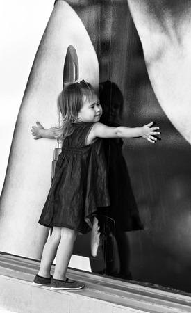 shop window: Little girl looking through shop window Stock Photo