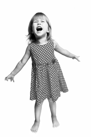 short sleeved: Funny little girl laughing isolated on white background