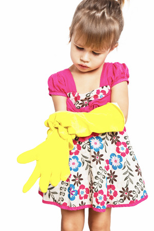 arms raised girl: Little girl in rubber gloves in on the white background Stock Photo
