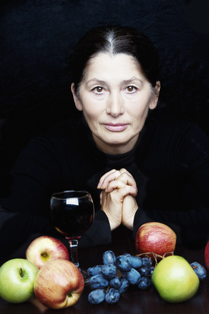 50s: Mature people healthy eating. Portrait of a 50s asian mature woman and fresh fruits.
