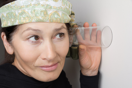 50 to 55 years: Mature woman, overhears via glass to the wall - curiosity