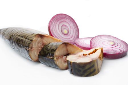 Pieces of smoked mackerel and red onion on white background