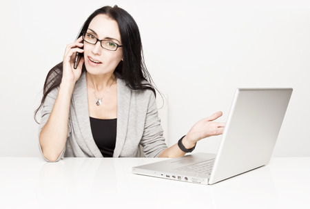 Young business woman with a computer Stock Photo