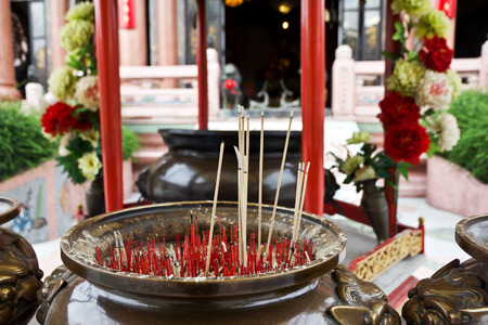 street creed: burning incense in chinese temple Stock Photo
