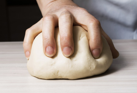 woman's hand: Womans hand kneading dough