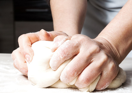 Hands kneading a dough