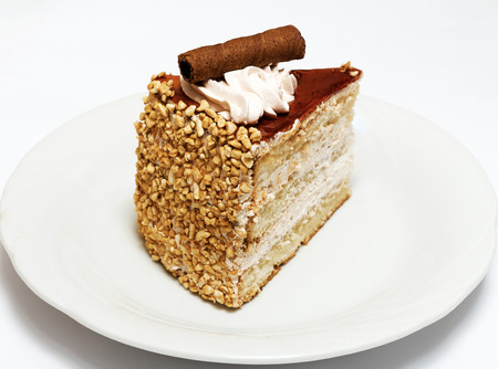 chignon: Sponge cake with cream and chocolate on white background