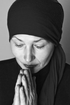 aged: Middle aged woman praying