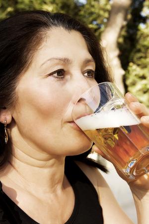 Woman drinks beer