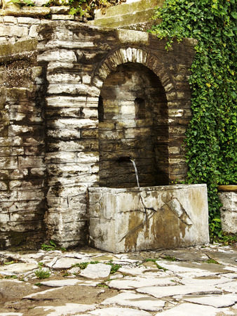source of iron: Old water source on street in historic part of Veliko Tarnovo, Bulgaria.