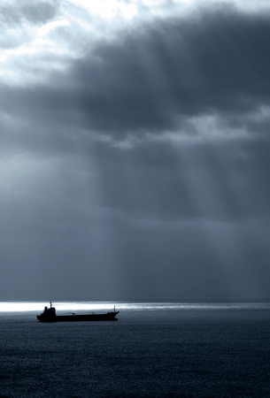 bleakness: Sea horizon with ripples against grey sky at dusk bleakness over seascape background