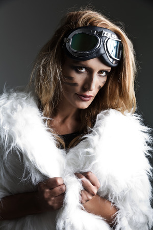 steampunk goggles: Portrait of young pretty woman fantasy steampunk style