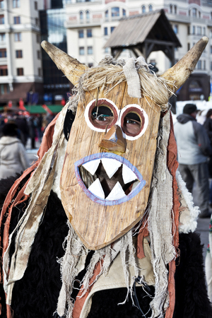 Moscow.Russia 25.02.2017. Russian national festival Shrove, dedicated to the wire in the winter. People dressed in vintage costumes and masks amuse people on the streets of Moscow