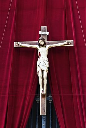 Rome, Vatican, Italy - April 14, 2017: Crucifixion on St. Peters Basilica in the Vatican.