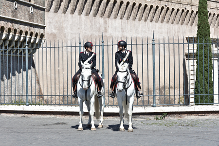 Rome, Italy - April 17, 2017: Two policemen on horseback department, security service at the famous Saint Angel castle