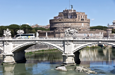 Rome, Italy - April 17, 2017: View on the famous Saint Angel castle and bridge over the Tiber river in Rome, Italy