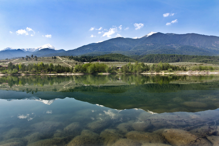 Amazing Panorama to the lake, Pirin Mountain background in Bansko, Bulgaria Stock Photo