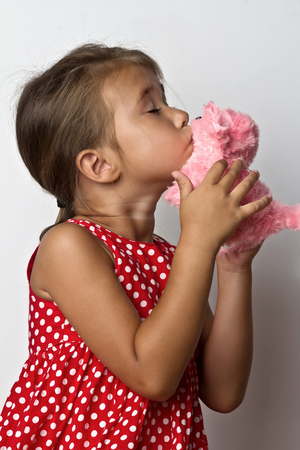 Beautiful little girl with a soft toys