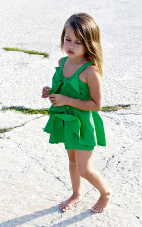 Little girl in green dress Stockfoto
