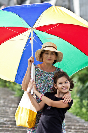 Happy grandmother and granddaughter in the sunny day.