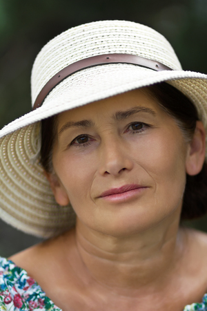 Portrait of a woman in a straw hat Stock Photo