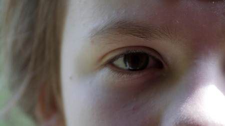 eye of young girl close up, have fun