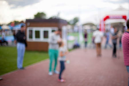 People, Family in a recreation park. Abstract blur people picnic in public park with family or friends, urban leisure lifestyle. Defocused background. Relaxation and recreation concept.