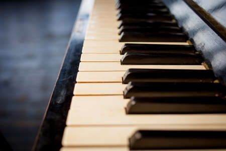 Keyboard piano close up photo, soft focus. Beautiful close up photo of piano keys. Piano keys close up photo selective focus. Piano keyboard close up side view, stock photo