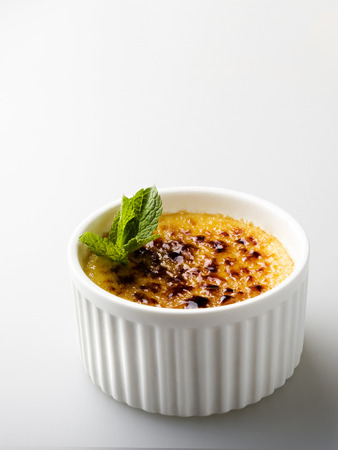 custard flavor: creme brulee served in a white porcelain dish