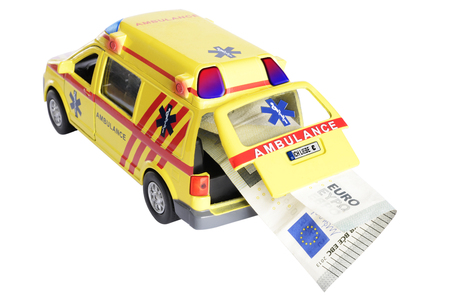 doomed: Euro note being transported by an ambulance isolated on white