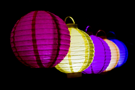 Colorful lampions lantern in the dark of night.