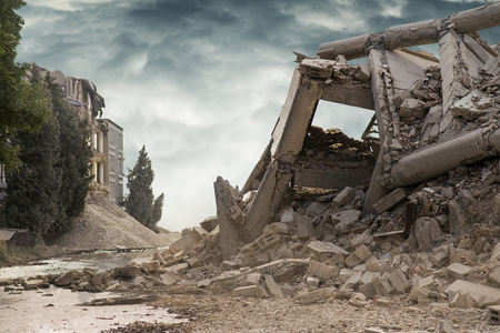 View on a collapsed concrete industrial building with dark dramatic sky above