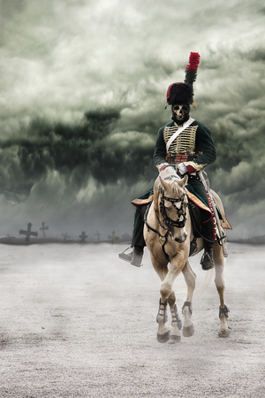Scary skeleton Napoleon officer riding a white horse with grave crosses behind him in background and with dark and dramatic clouds above. Death concept.