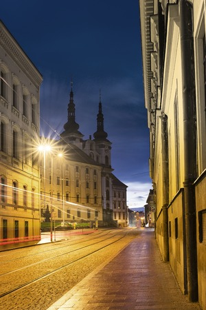 the square of the Republic with Church of Our Lady of the Snows and its towers in background at dusk. Olomouc, Czech Republic. Stock Photo