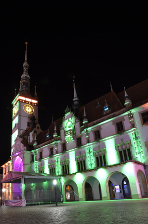 Olomouc Czech Rep 28th September Olomouc main square with astronomical clock and historical houses being lit up by color lights Stock Photo