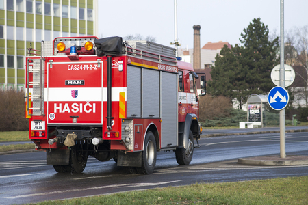 Prostejov Czech Rep 28th January - Fire truck leaving from water hydrant after being filled up and driving to the fire scene.
