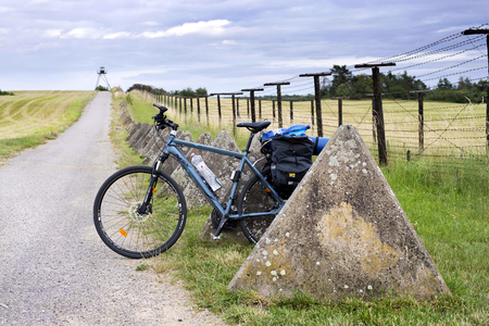 Cizov Czech Rep 23th June 2018 EuroVelo 13, bicycle with bags standing by the rest of the Iron Curtain at Czech - Austrian borders, south Moravia. The Iron Curtain Trail