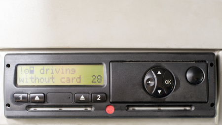 Digital tachograph display reads DRIVING WITHOUT CARD. No inserted card in the device. Insert the drivers card. No personal data